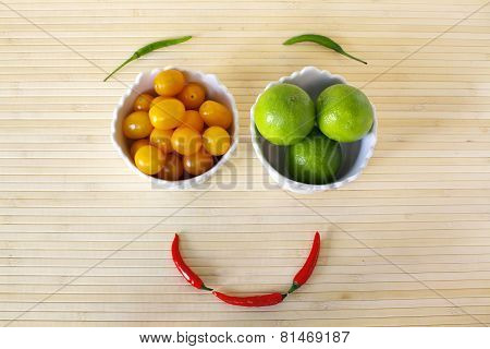 Healthy Eating Smiling Face From Vegetables And Fruits On Bamboo Background.
