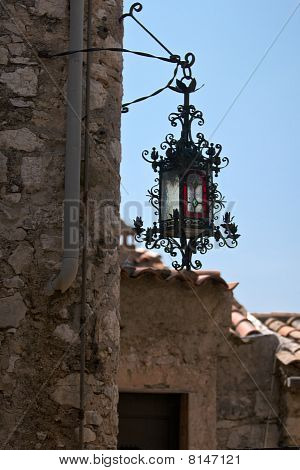 Metal Lamp And Fragment Of Stone House