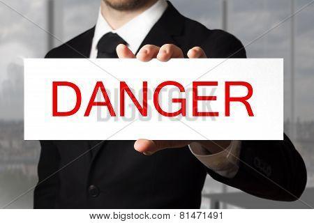 Businessman Holding Sign Danger