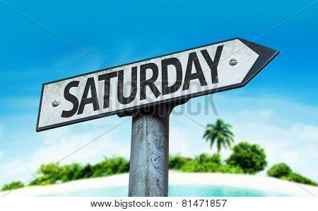 Saturday sign with a beach on background