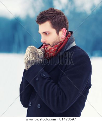 Handsome Man In Mittens Freezes Outdoors In Winter Cold Day