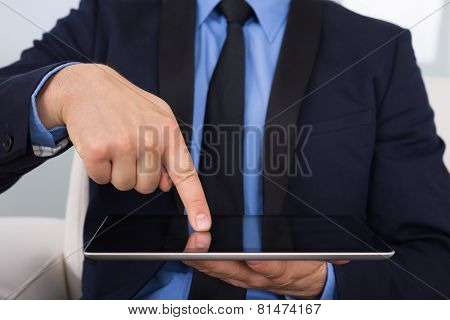 Businessman Touching Digital Tablet