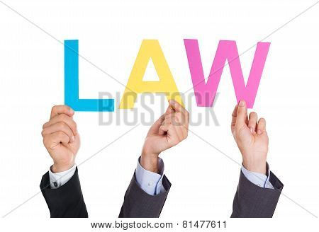 Businesspeople Hands Holding Word Law