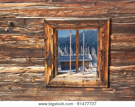 View of a ski hut by a wooden window