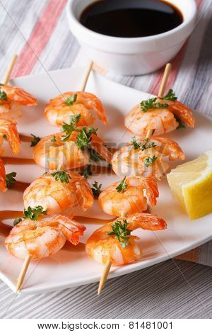 Grilled Shrimp On Skewers With Lemon And Sauce Vertical