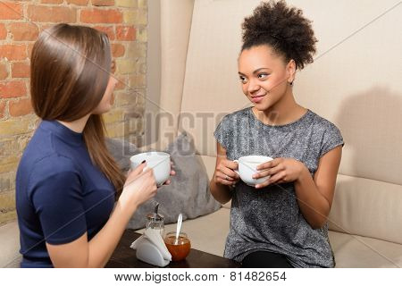 Two attractive girls in the cafe