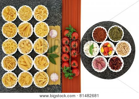 Italian and mediterranean food ingredients in porcelain bowls on marble over white background with tomato spaghetti.