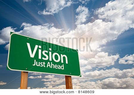 Vision Green Road Sign Over Clouds