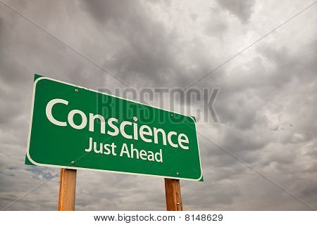 Conscience Green Road Sign Over Storm Clouds