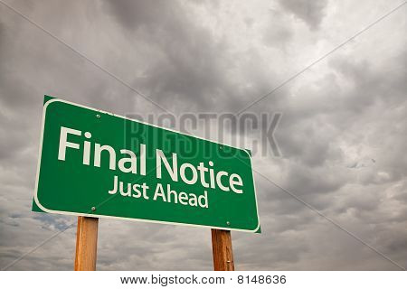 Final Notice Green Road Sign Over Storm Clouds