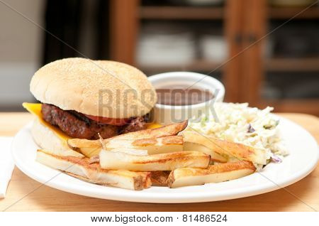 Juicy Hamburger With Fries And Cole Slaw, And Gravy