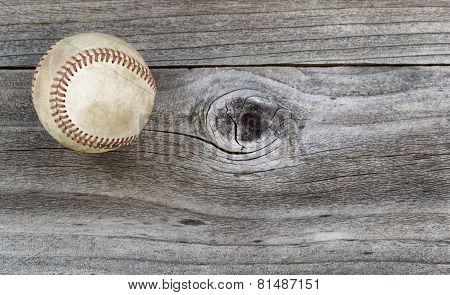 Old Baseball On Weathered Wood