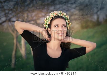 Happy Girl with Floral Wreath in Nature