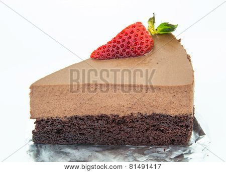 Piece Of Chocolate Cake Of Two Layers With Fresh Strawberries On Foil And White Background