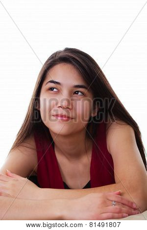 Beautiful Biracial Teen Girl Looing Up With Happy, Spunky Expression