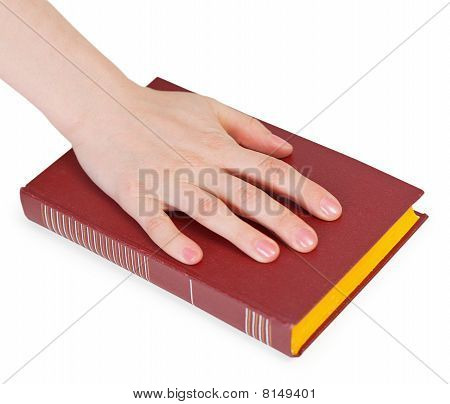 Hand Of Person Reciting The Oath On Book