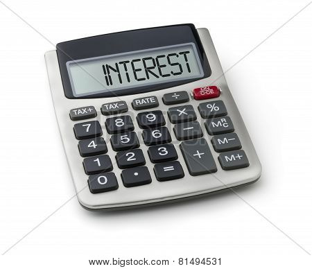 Calculator with the word interest on the display