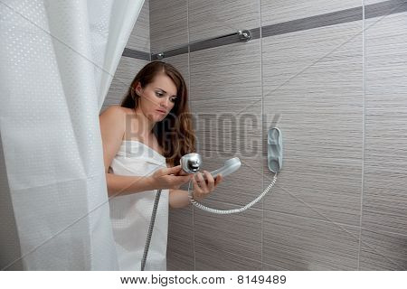 attractive woman making call in bathroom