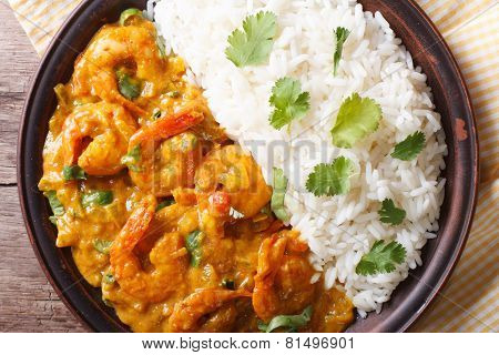 Shrimps In Curry Sauce And Rice Close-up. Horizontal Top View