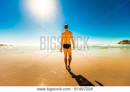 Man Walking Into The Ocean