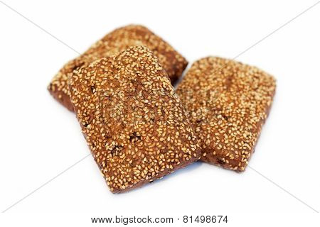 Three baked biscuits on white background
