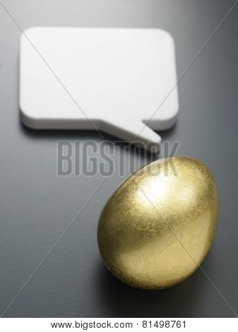 golden egg with the speech bubble