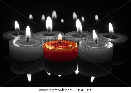 Red Candle With Flame On Black And White