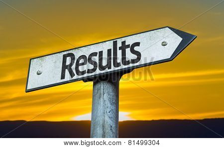 Results sign with a sunset background