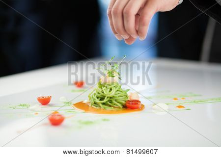 Chef Preparing A Pasta Dish