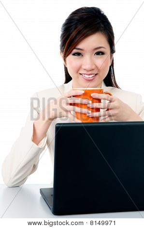 Adorable Young Businesswoman Holding Coffee Cup