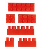picture of foreshortening  - Set of red plastic toy construction block bricks isolated over the white background - JPG