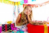 image of boring  - Bored gesture blond kid girl in party with chocolates and puppy chihuahua dog - JPG