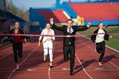 picture of race track  - business people running together on racing track - JPG
