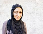 stock photo of middle eastern culture  - Arabic Muslim Middle Eastern girl on wall background - JPG