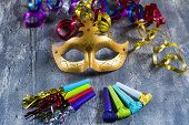 pic of blowers  - Carnival mask with colorful streamers and party blowers - JPG