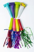 image of blowers  - Party Blower of different colors on white background - JPG