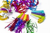 stock photo of blowers  - Party items blowers and colorful streamer in white background - JPG
