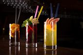 stock photo of bomb  - Cherry bomb screwdriver and cuba libre cocktails in a tall glasses on the dark background - JPG