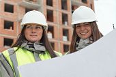stock photo of inspection  - Civil Engineers at at construction site are inspecting ongoing production according to design drawings. ** Note: Soft Focus at 100%, best at smaller sizes - JPG