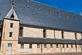 stock photo of hospice  - famous hospice in Beaume France under blue sky - JPG