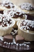 picture of chocolate muffin  - Muffins with chocolate icing with sugar grains and chocolates in a heart - JPG