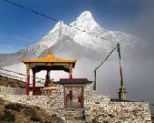 stock photo of stature  - New statue of buddha in Pangboche monastery and mount Ama Dablam Khumbu valley near Tengboche way to Everest base camp Nepal - JPG