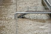 stock photo of flood  - Swollen river flooded roads and bridges for pedestrians - JPG