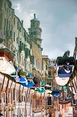 stock photo of street-rod  - An abstract view of empty boats moored and lined up along the sidewalks of a water canal in Venice Italy - JPG
