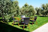 foto of lawn chair  - The chairs and table are on lawn in luxury hotel Antalya Turkey - JPG