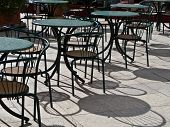 stock photo of french culture  - cafe tables and chaires french style with shadow - JPG