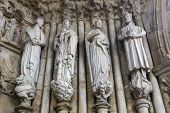 foto of minos  - Statues of Catholic Saints at the Entrance Portal of the Cathedral of Tui Galicia Spain - JPG