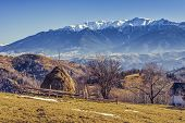 foto of haystack  - Alpine rural landscape with sheepfold and haystack in the valleys of Bucegi mountains Brasov county Romania - JPG