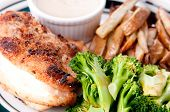 picture of dipping  - crispy skinned roast chicken breast with dipping sauce hand cut french fries  - JPG