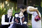 stock photo of biracial  - Biracial bride kissing her little brother on her wedding day - JPG